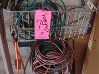 1 lot of brooms   ext cords