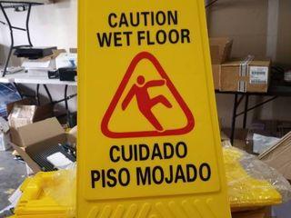 set of three caution wet floor signs English and Spanish