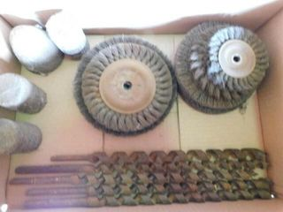 Box of wood bits  grinding brushes  and stone