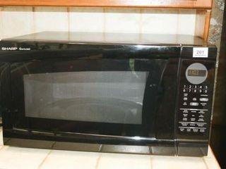 Sharp Carousel Microwave Oven powers on