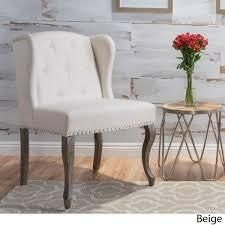 nicolas wing back studded fabric chair beige