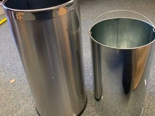 Tin trashcan with pale inside