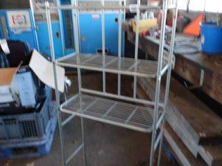 Behind the toilet metal rack
