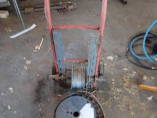 2 wheel dolly customized for holding electric fence wire   3 rolls of electric fence wire