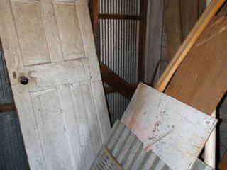 Old wood door   lots of various lumber   metal