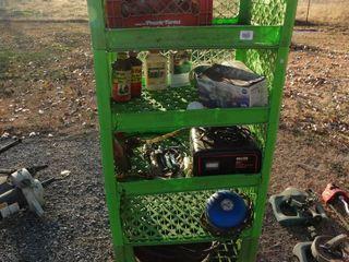 Green plastic shelf unit w  contents