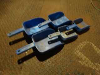 lot of 5 Feed Scoops