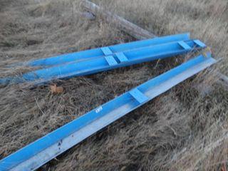lot of blue metal feeding troughs
