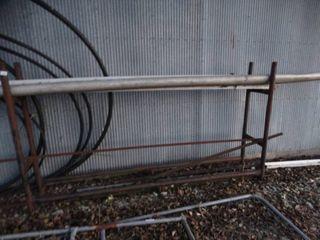 Metal firewood rack   plastic tubing