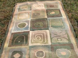 91 x 62 Inch Area Rug location Front Storage