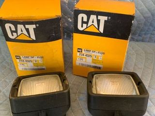 Pair of CAT Head lamps No  234 4325 location Front Storage