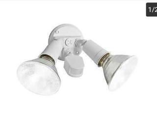 Utilitech Motion Activated Hard Wired Security light     Not Inspected an Comes with No Bulbs