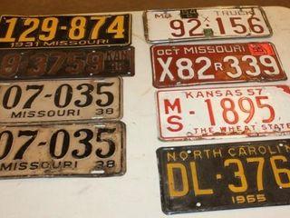 8 Vintage license Plates