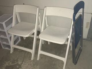 2  White Plastic Folding Chairs   Storage Drawers