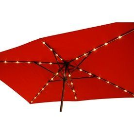 Simply Shade Red Market Pre lit 7 ft W x 10 5 ft l Patio Umbrella  SOlAR PANEl MISSING  NOT FUllY INSPECTED OUTSIDE BOX