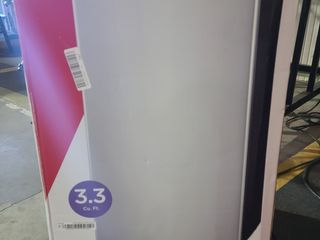 Frigidaire   3 3 Cu  Ft  Mini Fridge   Silver powers on and cools  Dent in door