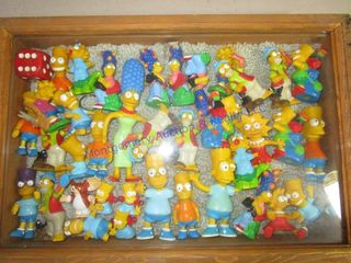 SIMPSONS FIGURES IN DISPlAY CASE