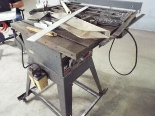 Craftsman 10  3 HP table saw on rollers
