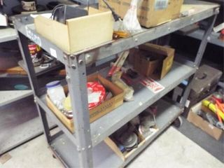 Metal cart on rollers with contents