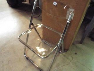 4 ea  Clear Plastic folding chairs