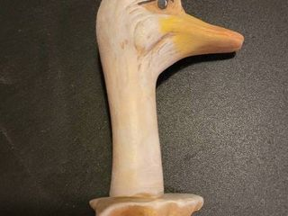 Wooden ducks head for knows what