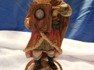 11  Ceramic Santa holding a music box