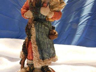 11  Ceramic Santa holding a Christmas Tree