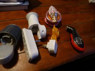 lot of Plug in Air Fresheners and Tire Gauge