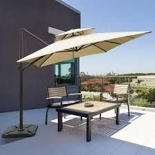 Segero 9x12 Dual Wind Vent Cantilever Umbrella with Cross Base by Havenside Home  Retail 279 99
