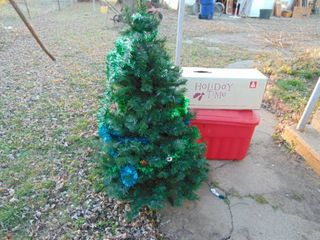 Artificial Tree   Missing one Foot and 1 large Tote