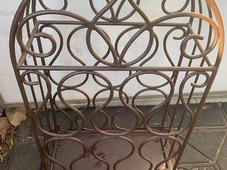 Really nice iron wine rack on wood pedestal