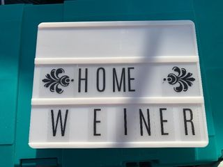 Small light up sign letters stored in back along with USB cord