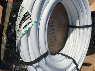 New 100 foot roll of watering hose