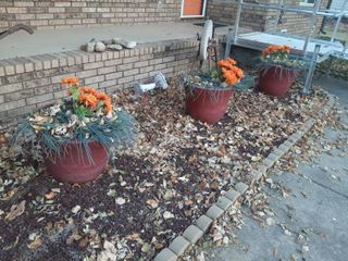 3 Plastic Planters with Faux Flowers