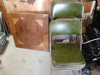 Card Table and 4 Chairs   Table is Missing Some Veneer