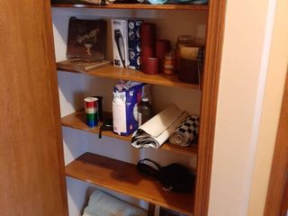 Contents of Closet   Hair Clippers and Candles