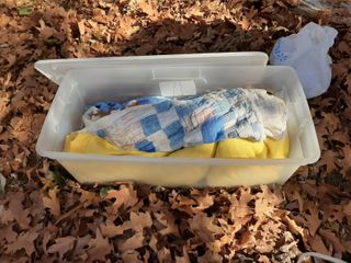 Tub with Damaged Quilt and Blanket