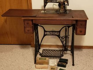 Antique Singer Sewing w Cabinet and Attachments  36 x 17 x 31 in  tall    has been modified for electrical operation however no belt