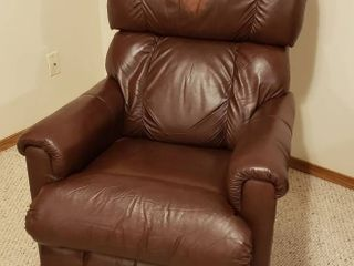 lazBoy leather Rocker Recliner   33 x 38 x 40 in  tall   Seat  18 in  wide   some coloration damage on Head cushion   In Basement   bring help to move
