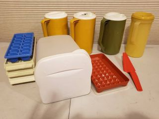 4 Plastic Pitchers  4 Ice Trays  Rubbermaid Bread Storage and Tupperware Spatula   Cooking Dish