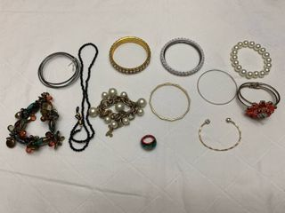 ladies jewelry  10 bracelets  one glasses holder and one ring