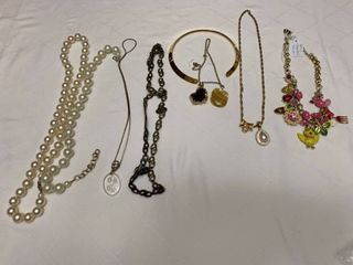 Assorted ladies jewelry  eight necklaces and two pendants one necklace is Betsey Johnson