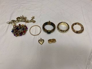 Assorted ladies jewelry  six bracelets  one heart pendant and one pin