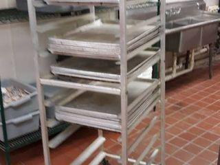 aluminum sheet pan rack with some pans