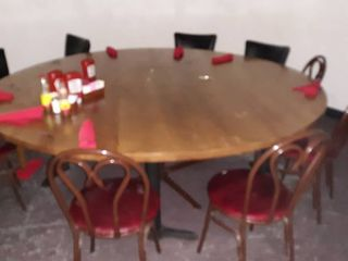 7 foot round wood table w 10 chairs