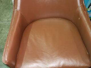 Brown swivel faux leather chair   see photo