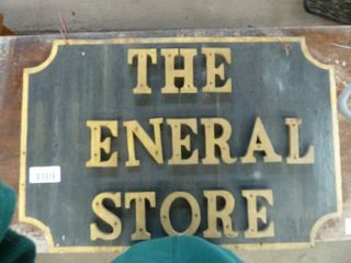 early wooden  The General Store  sign