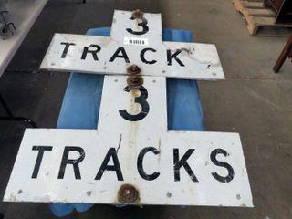 2 aluminum tracks signs