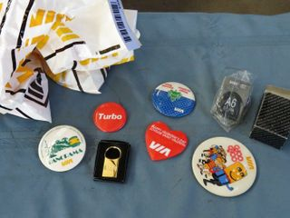 2 bags of VIA giveaway pins
