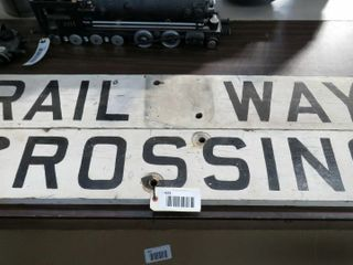 single sided wooden railway crossing sign